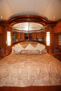Master Stateroom with centerline king bed, storage, vanity/desk with an ensuite