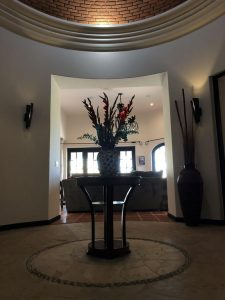 Entry way with custom brick dome. Flowers on arrival