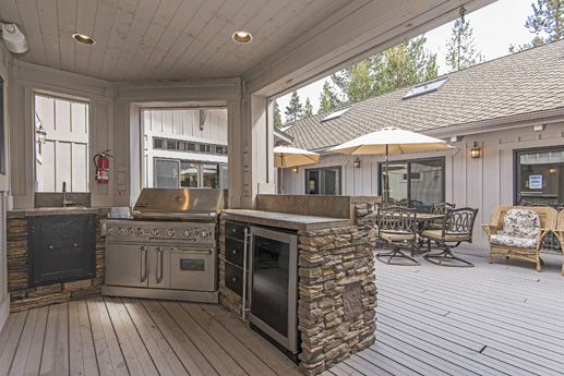 Outdoor kitchen just off the main kitchen; sliding glass doors
