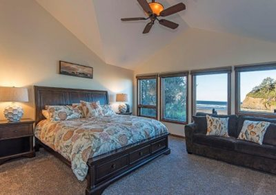 Master bedroom 1 with attached bath and ocean views