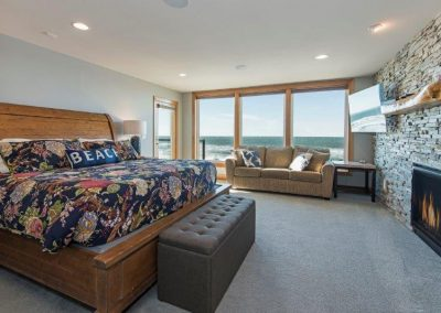 "Bedroom 3- King bed. Ocean front deck, queen sleeper sofa, fireplace, 55"" HDTV"