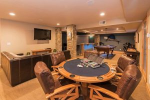 Game room with poker table, shuffle board, pool table